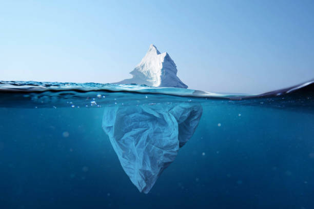 iceberg - plastic bag with a view under the water. pollution of the oceans. plastic bag environment pollution with iceberg. - iceberg ice formation stock pictures, royalty-free photos & images