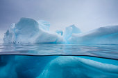 Under and over water view of an iceberg in Crystal Sound, Antarctic Peninsula