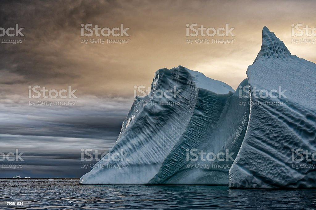 Iceberg Wave Sunset Greenland Uunartoq stock photo