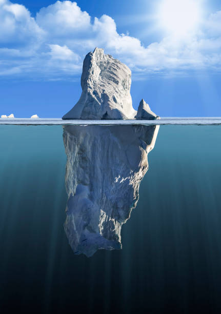 iceberg with above and underwater view - iceberg stock photos and pictures