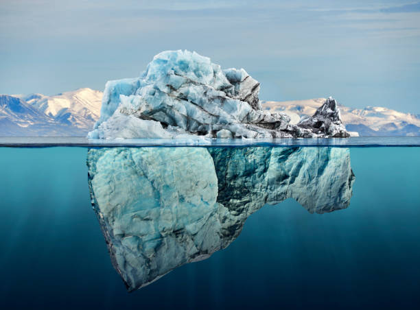 iceberg with above and underwater view - changing form stock pictures, royalty-free photos & images