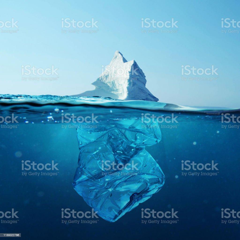 Iceberg with bottle in the ocean underwater. Environmental pollution. Plastic water bottles pollute ocean. Iceberg with bottle in the ocean underwater. Environmental pollution. Plastic water bottles pollute ocean. Antarctica Stock Photo
