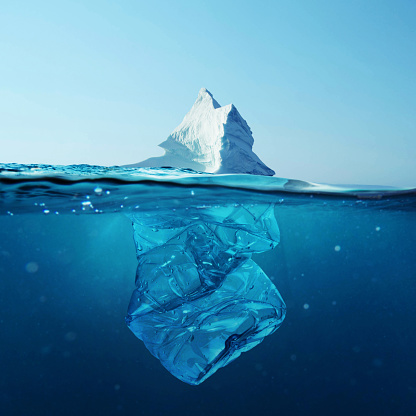 Iceberg With Bottle In The Ocean Underwater Environmental Pollution Plastic Water Bottles Pollute Ocean Stock Photo - Download Image Now