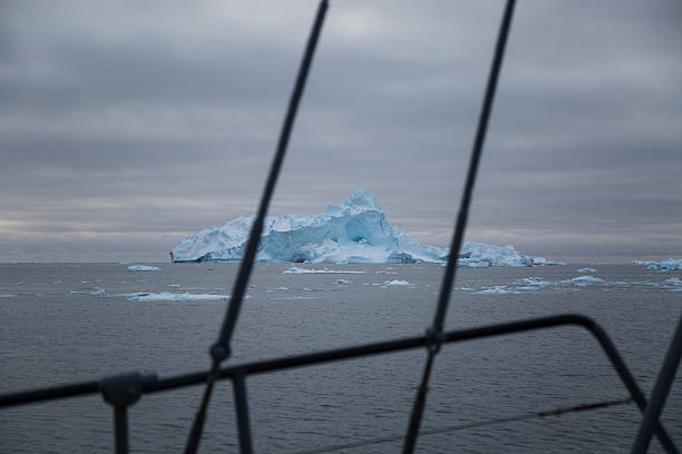 Iceberg with rigging in foreground stock photo