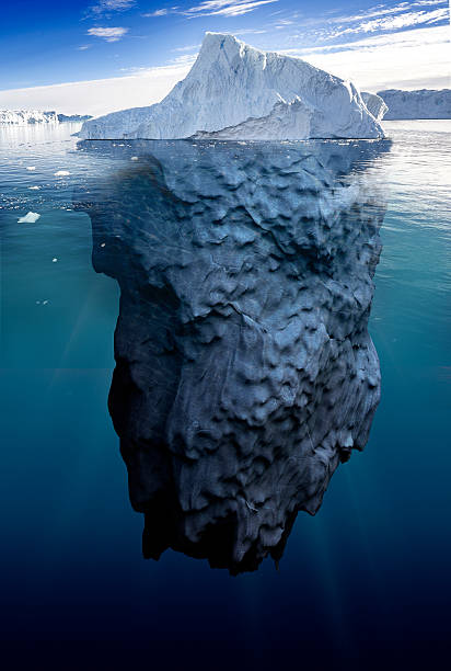 iceberg with underwater view - iceberg stock photos and pictures