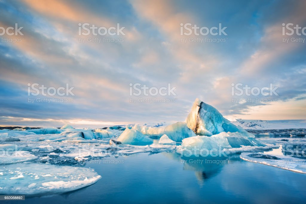 Icebergs float on Jokulsarlon glacier lagoon, in Iceland. stock photo
