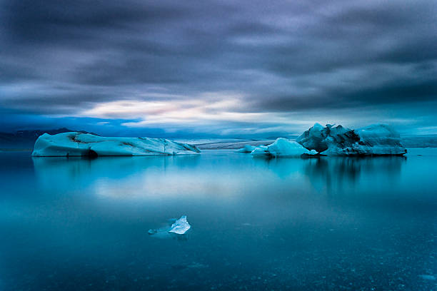 Icebergs Floating in Jokulsarlon Glacier Lagoon, South Iceland Icebergs floating in Jokulsarlon glacier lake. South Iceland. glacier lagoon stock pictures, royalty-free photos & images