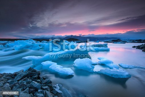 istock Icebergs floating in Jokulsarlon glacier lake at sunset 469365962
