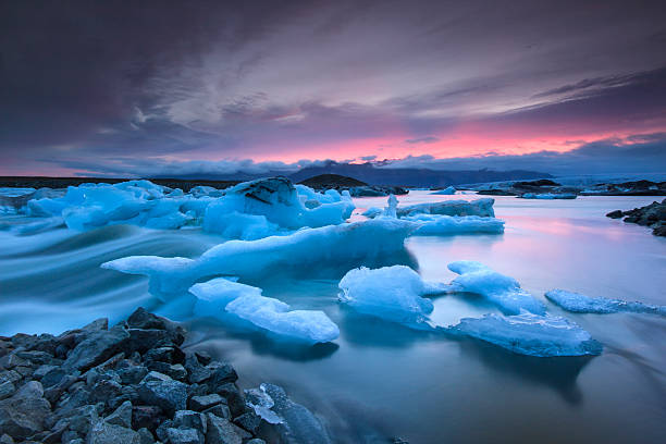 Icebergs floating in Jokulsarlon glacier lake at sunset Icebergs floating in Jokulsarlon glacier lake at sunset.South Iceland. ice floe stock pictures, royalty-free photos & images