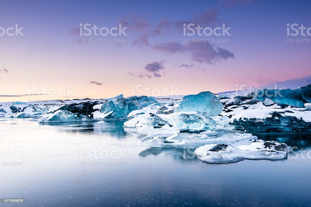 Icebergs floating in Jokulsarlon glacier lake at sunset. South Iceland. stock photo