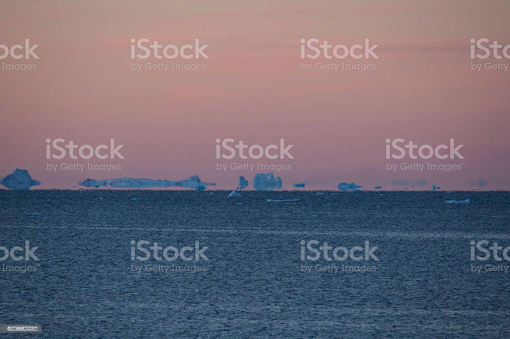 Icebergs floating near horizon stock photo