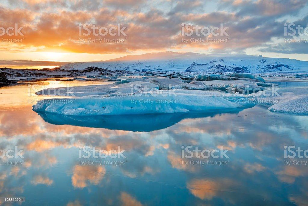 Icebergs in Jokulsarlon glacier lake at sunset stock photo
