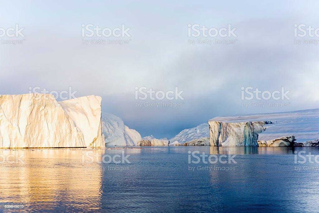Icebergs on arctic ocean in Ilulissat icefjord, Greenland stock photo