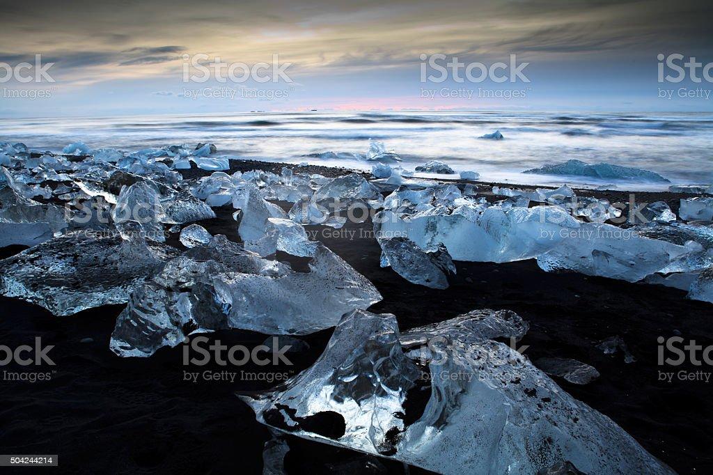 icebergs on black sand beach stock photo