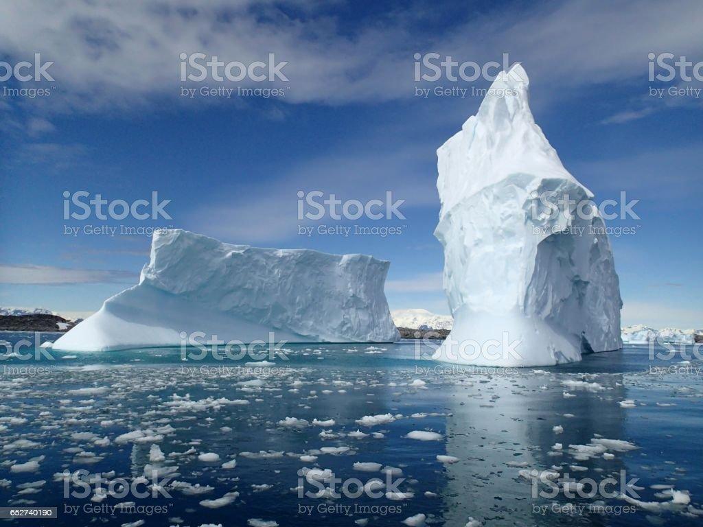 Icebergs An Iceberg floats off the Antarctic Pennisula Antarctica Stock Photo