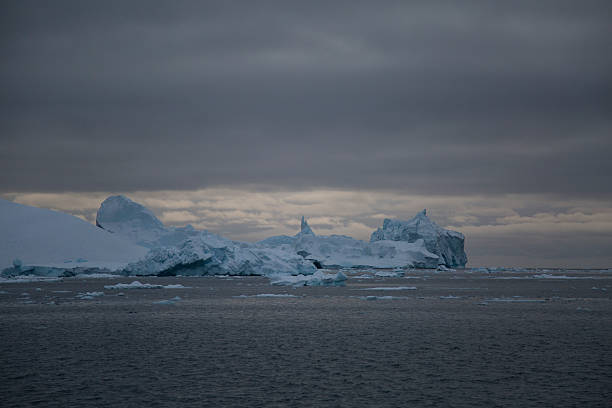 Icebergs with sinister sky stock photo