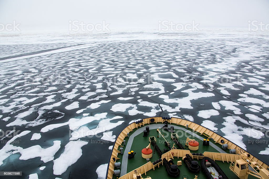 Icebreaker in the Arctic ocean cruising in pack ice stock photo