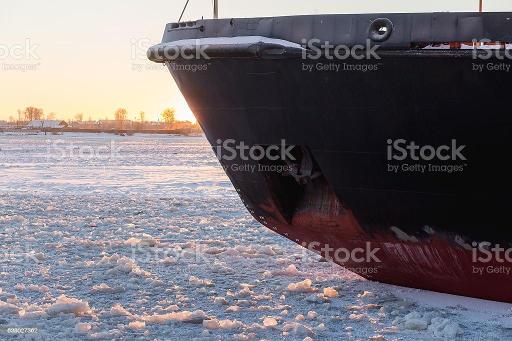 Icebreaker in the river ice. Nose of ship. stock photo