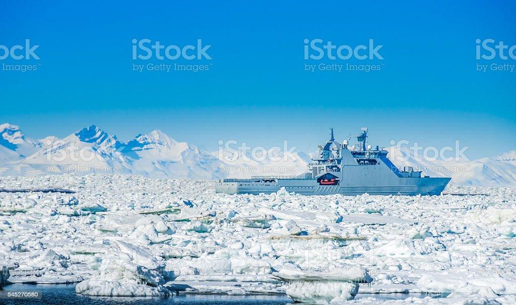 Icebreaker ship surrounded by icebergs, Spitsbergen, Svalbard, N stock photo