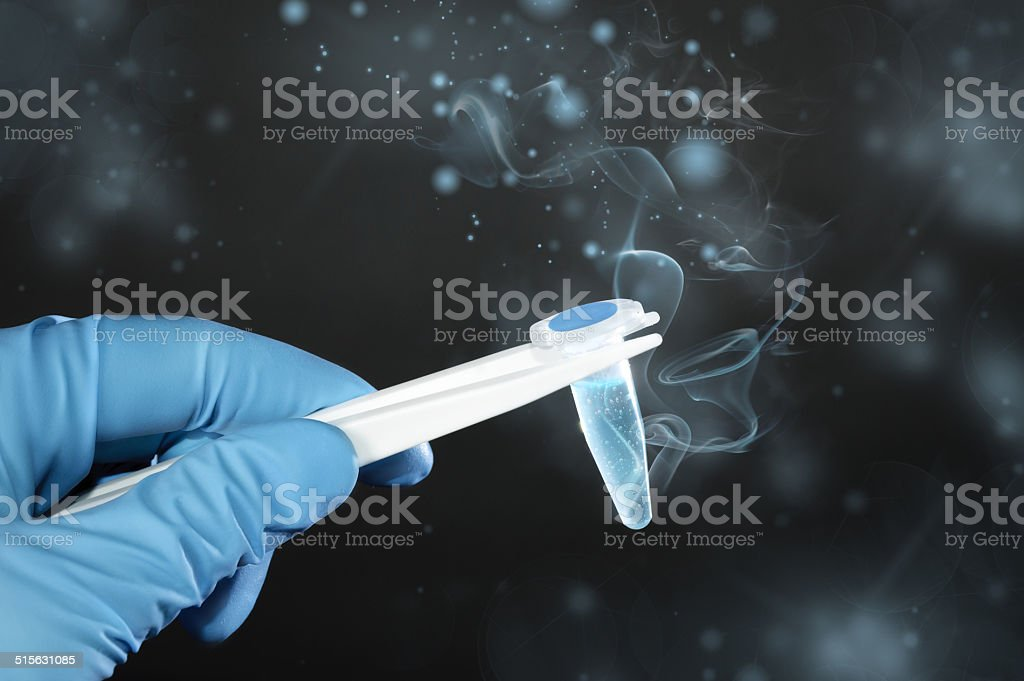 Ice-cold scientific or medical sample on dark background stock photo