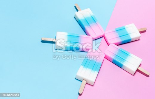 istock ice-cream on pink and blue background 694326654