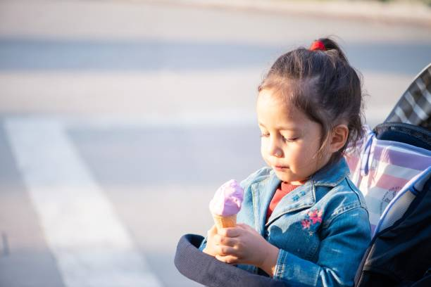 Ice-cream time for a little girl stock photo