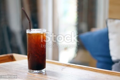 Iced americano - A glass of black coffee on table and copy space, The style of coffee prepared by brewing espresso and mixed with water, Perfect for breakfast time, Refreshing summer drink concept.