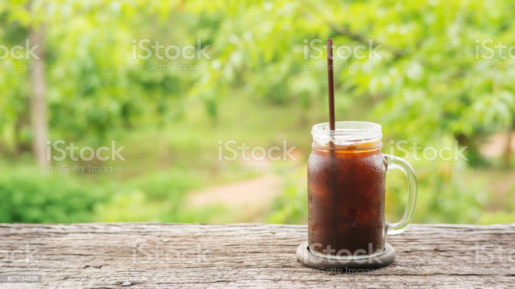 Iced americano coffee on nature background. stock photo