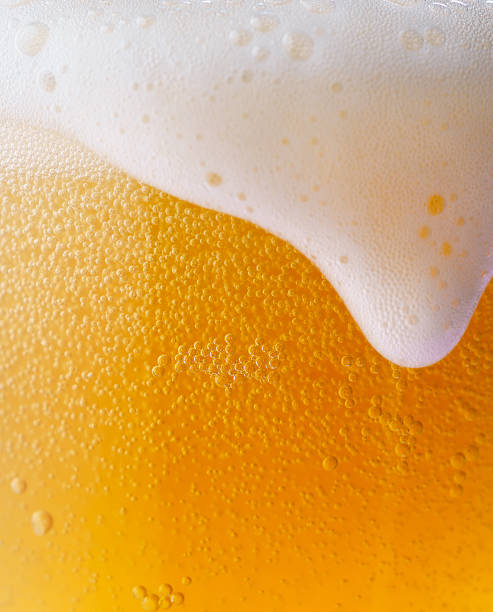 iced beer - beer foam stock photos and pictures