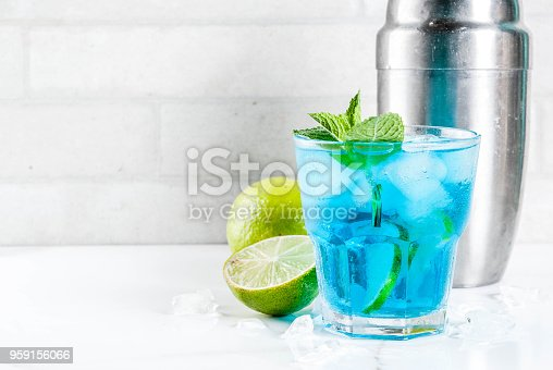 istock Iced blue alcohol cocktail 959156066