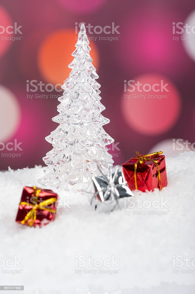 Iced Christmas Tree with gift boxes laying on snow stock photo
