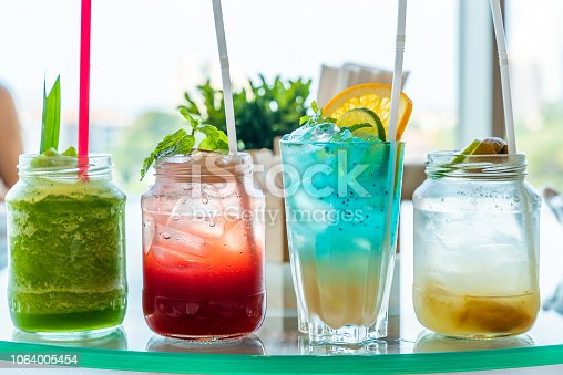variety of iced fruit juice cocktail and mocktail on glass table