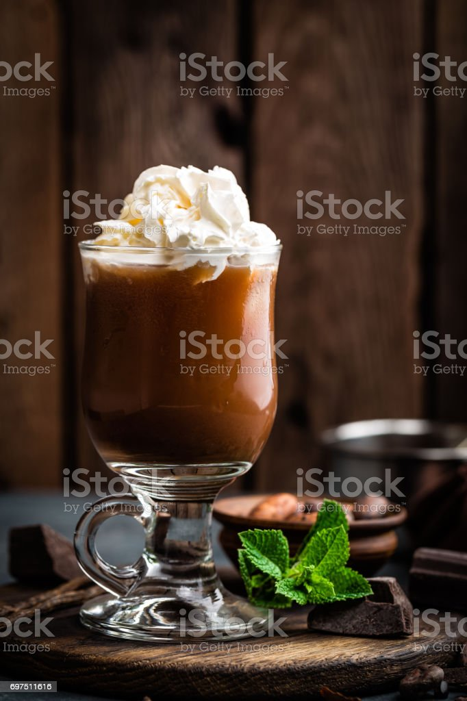 Iced cocoa drink with whipped cream, cold chocolate beverage, coffee frappe on dark background stock photo