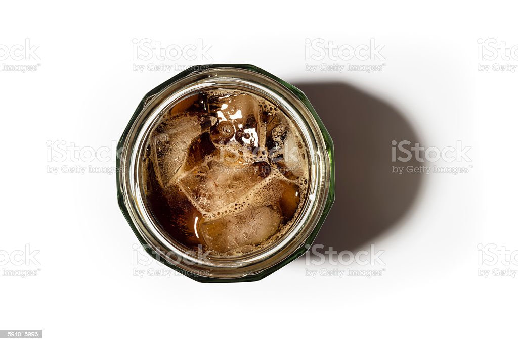 Iced Coffee in a masonry Jar from above against white stock photo