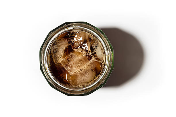 iced coffee in a masonry jar from above against white - iced coffee stock pictures, royalty-free photos & images