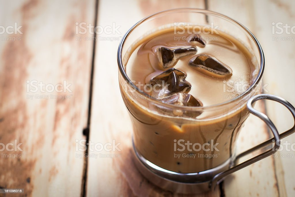 Iced coffee in glass and metal cappuccino cup stock photo
