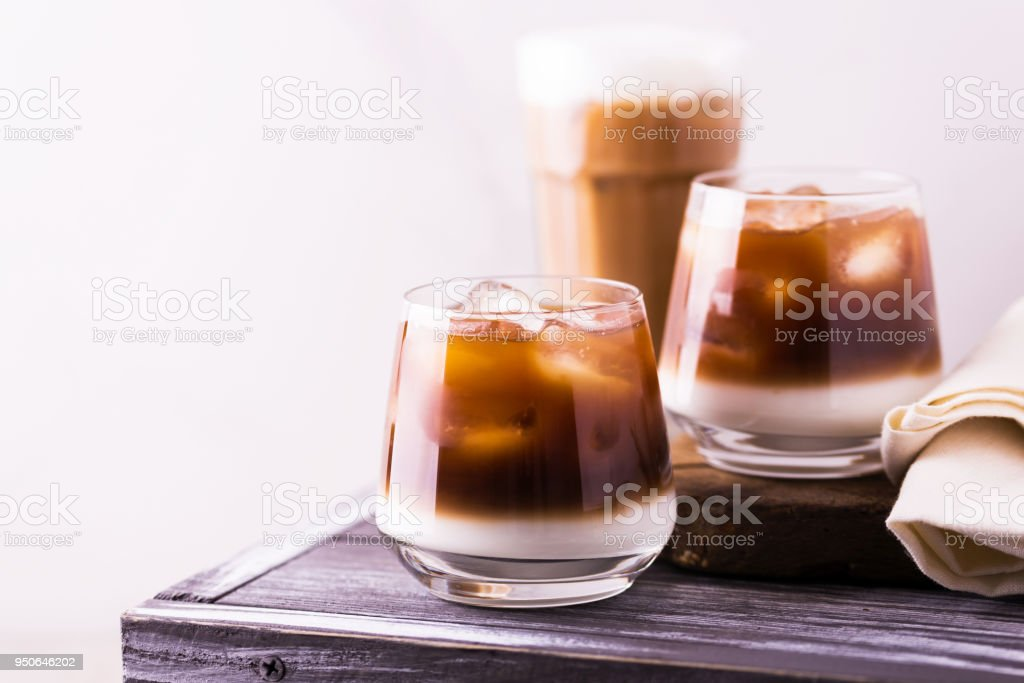 Iced coffee in glasses with milk. Black background stock photo