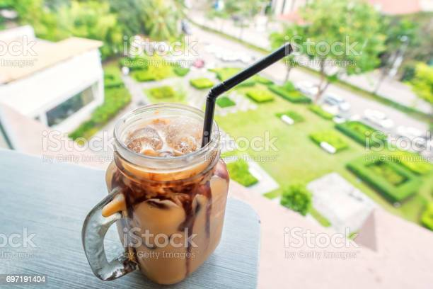 Iced coffee on table over green garden background picture id697191404?b=1&k=6&m=697191404&s=612x612&h=fncveooibpdtdb5aju6 x7mm82yvuiqi1vjjocxii90=