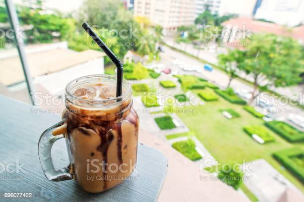 Iced coffee on table over modern city background picture id696077422?b=1&k=6&m=696077422&s=612x612&h=zcqkax5xbn  voxo6pikurgjhkbtxrnggfhxudtvlks=