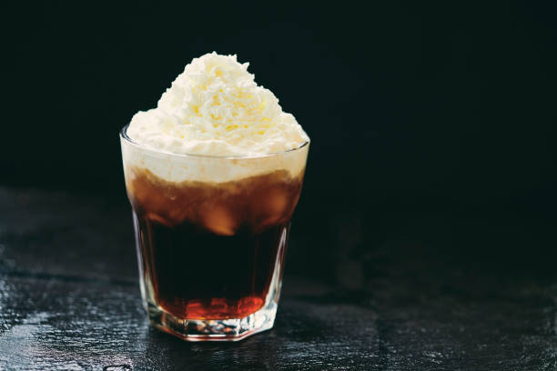 iced coffee topped with whipped cream. - iced coffee stock pictures, royalty-free photos & images