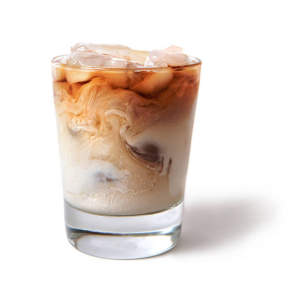 iced coffee with cream swirling into it - eiskaffee getränke stock-fotos und bilder