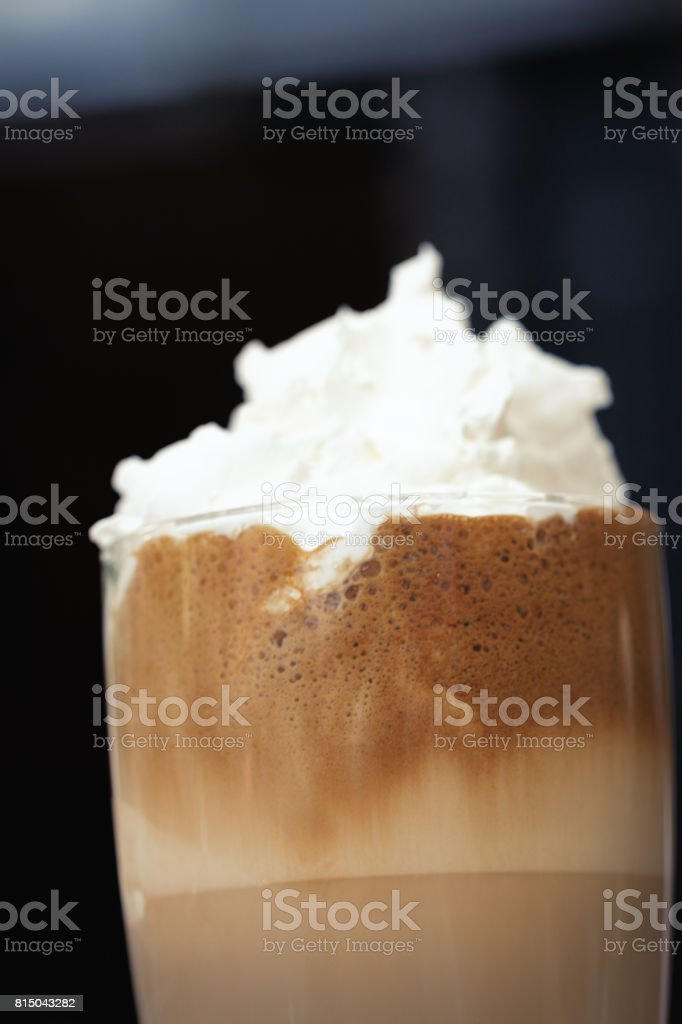 Iced coffee with cream -  vertical stock photo