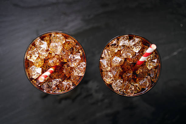 iced cola soda pop with straw in flay lay composition - foto de stock