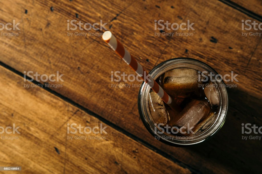 Iced Cold Brew Coffee in a masonry jar from above. stock photo