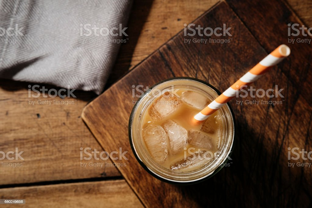 Iced Cold brew Coffee with milk served in a masonry jar. stock photo