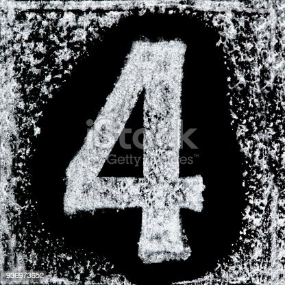 istock Iced digit / number 4 printed white ink stamp on black isolated background. Cut out. 936973652