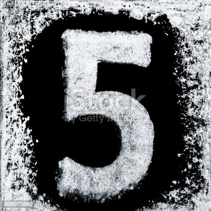istock Iced digit / number 5 printed white ink stamp on black isolated background. Cut out. 936973660