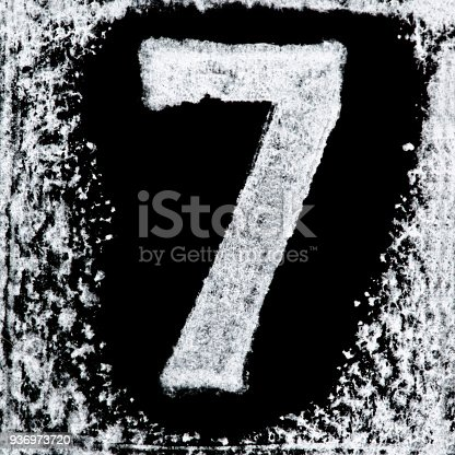 istock Iced digit / number 7 printed white ink stamp on black isolated background. Cut out. 936973720