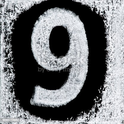 istock Iced digit / number 9 printed white ink stamp on black isolated background. Cut out. 936973682