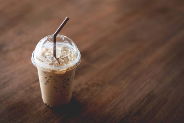 Iced espresso on the wooden table background with nature light stock photo